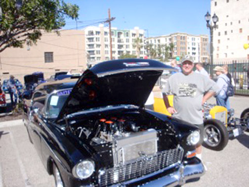 Cars, like this 1956 Chevy with Jerry Collins, can be seen at the March 20 charity car show.