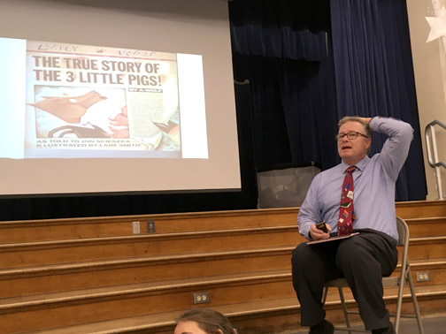 Principal, Dr. Reynolds reading his favorite story