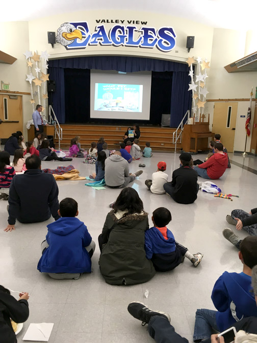 Valley View families listen as reading night begins