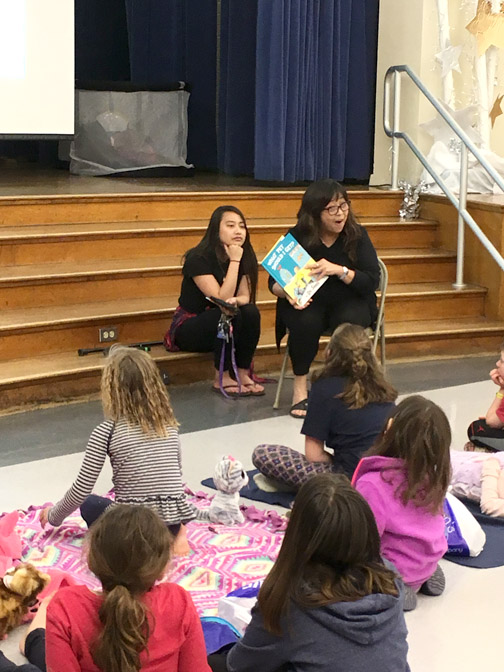 Valley View librarian, Mrs. Maribel Sibulo, reads a Dr. Seuss book
