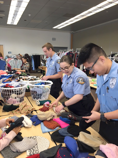 Photo by Mary O'KEEFE Glendale Police Explorers help at the first Glendale Cops for Kids Clothing Drive on Saturday.