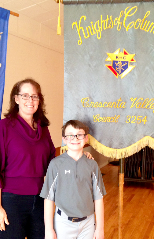 Photo provided by St. James-Holy Redeemer Schools Kenny Carpenter with his fifth grade teacher Maureen Moran.